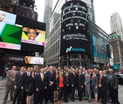 The Virginia Tech visitors pose in front of MarketSite's display tower in Times Square.